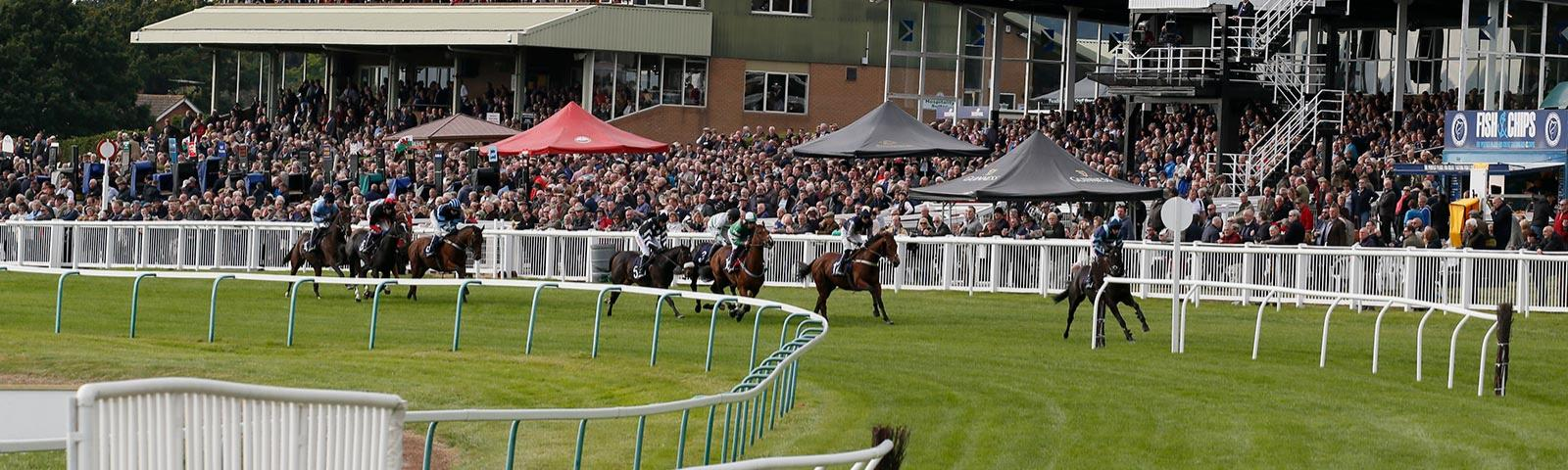 Racing turning out of home straight at Hereford Racecourse