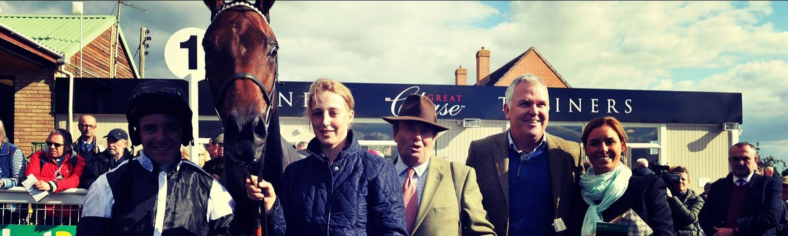 owners and trainer in winning enclosure